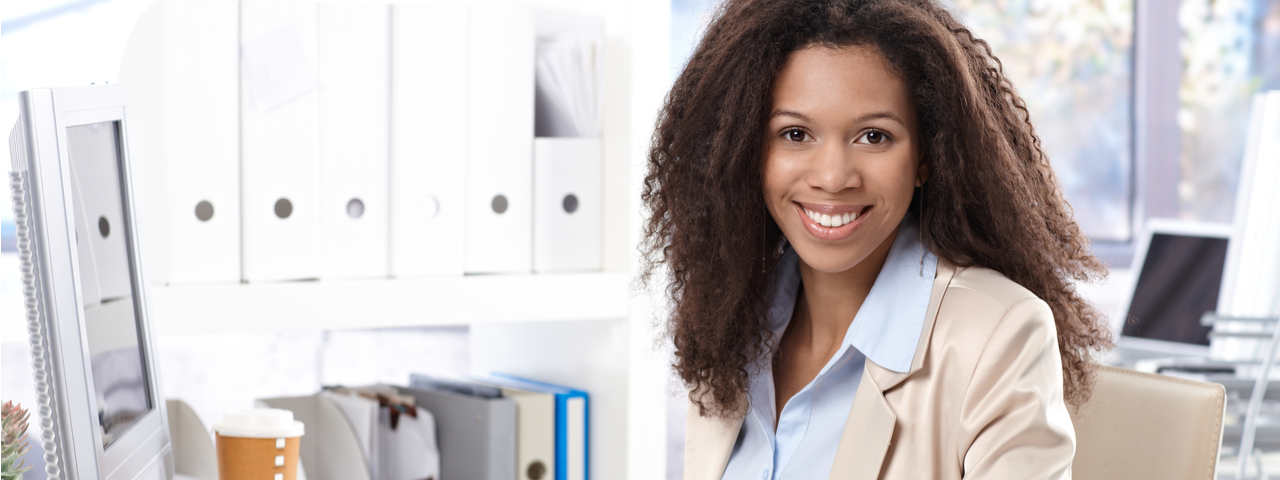 woman dressed in business attire smiling at camera