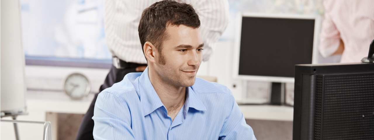 Worker at desk looking at computer